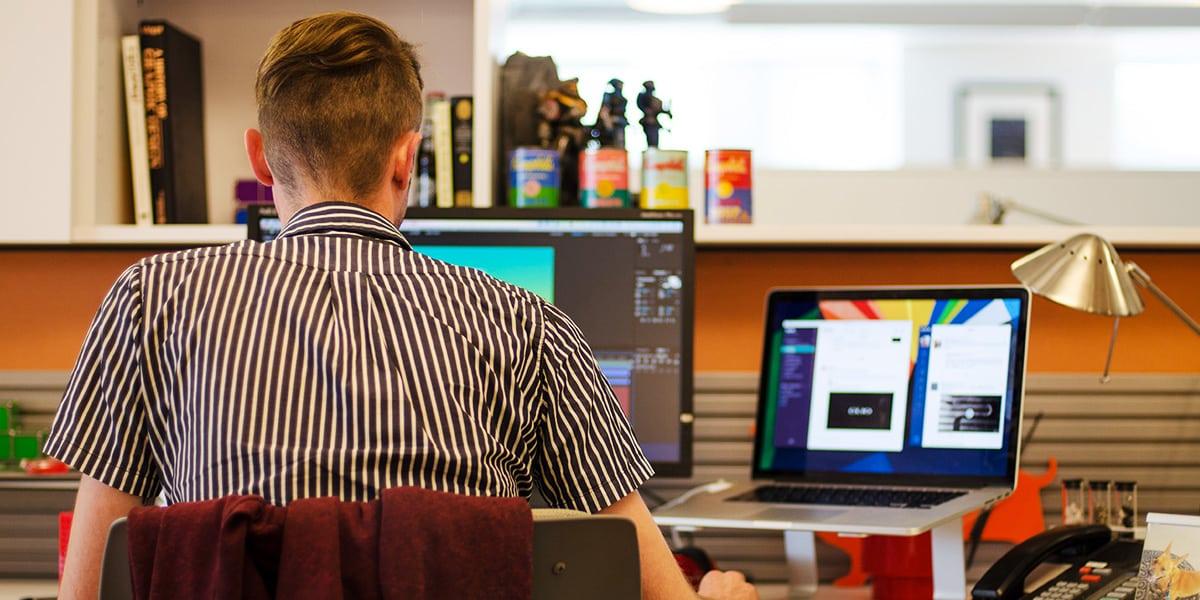 Eric Roden, Interactive Designer, working on his desk