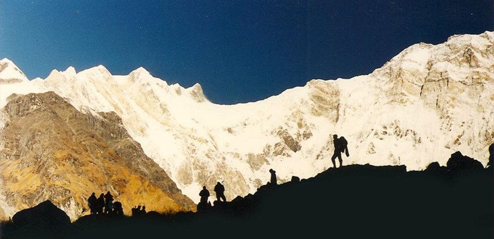 Picture of hikers on a mountain range on David Collins bio page.