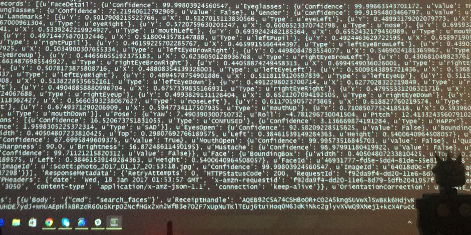 A picture of code projected on a wall.